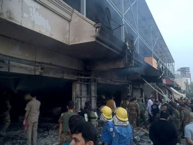 PHOTO: Emergency workers gather at the scene of a car bomb in northern city of Irbil, Iraq, April 17, 2015.