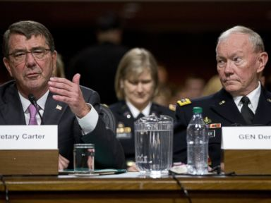 PHOTO: Chairman of the Joint Chiefs of Staff, Gen. Martin Dempsey, right, looks to Defense Secretary Ash Carter, left, as he testifies at the Senate Armed Services Committee hearing on Capitol Hill in Washington, D.C. on July 7, 2015.