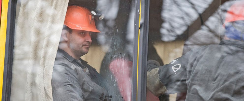 PHOTO: Miners sit on a bus after an explosion at the Zasyadko coal mine in Donetsk, Ukraine, March 4, 2015.