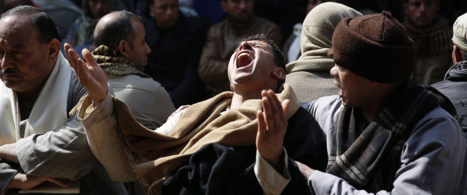 PHOTO: Egyptian Coptic men mourn for 21 Coptic Egyptian men seized by Islamic State militants
