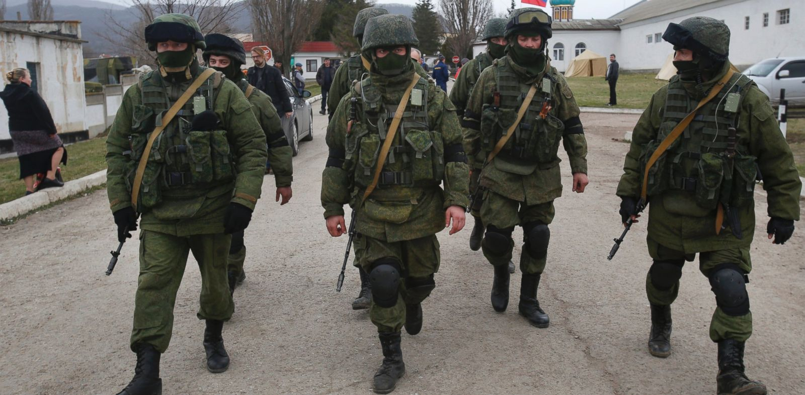 PHOTO: Pro Russian soldiers guarding Ukraines infantry base in Perevalne, Ukraine, patrol the area March 4, 2014.