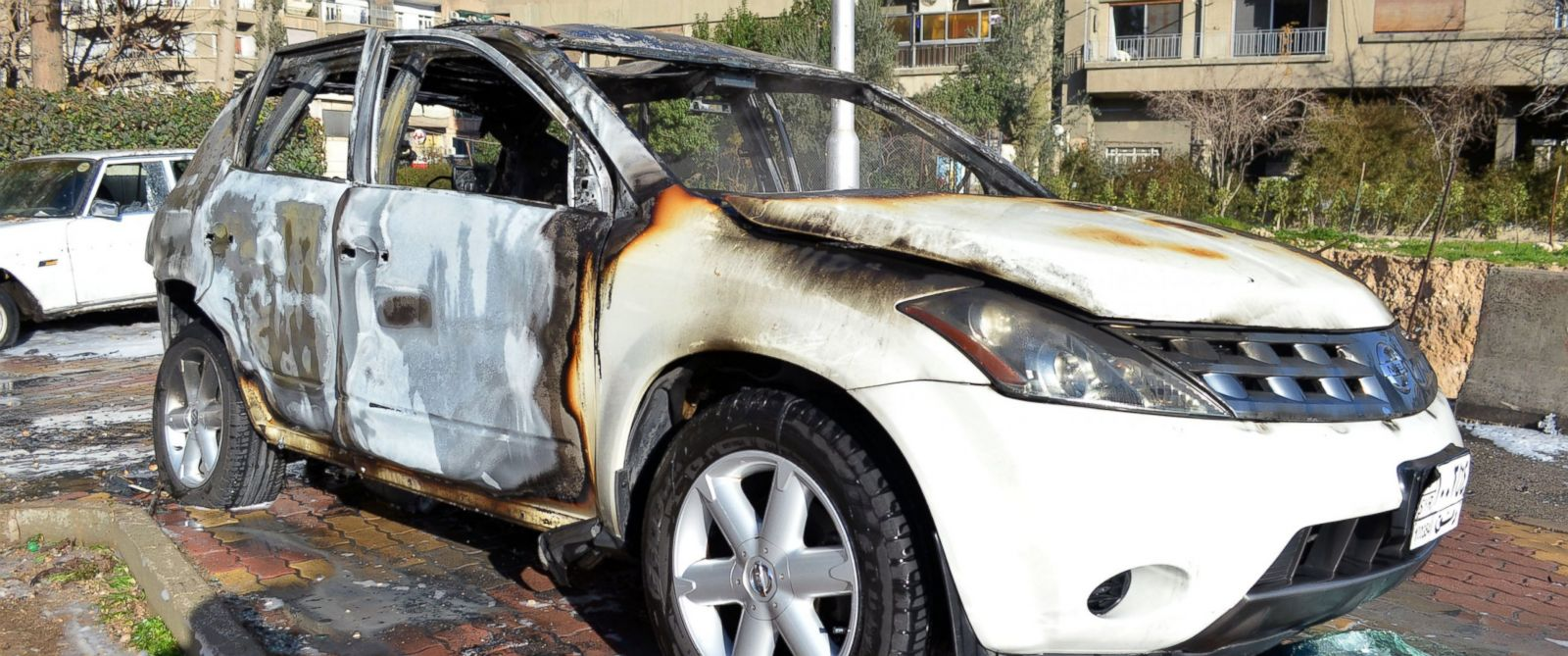 PHOTO: A car is seen here that was burned after rebels fired rockets and mortar shells in the capital Damascus, Syria on Feb. 5, 2015..