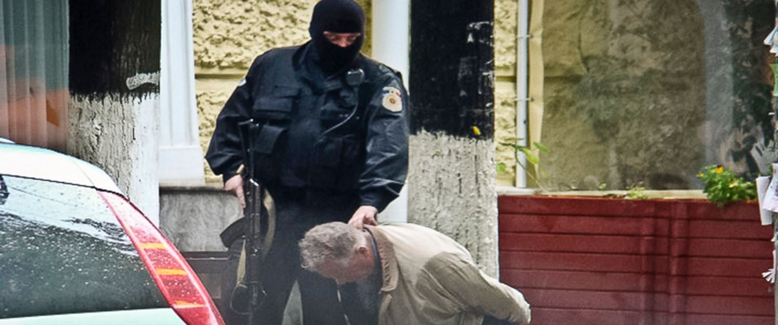 PHOTO: Teodor Chetrus is detained by a police officer in Chisinau, Moldova during a uranium-235 sting operation, June 27, 2011.