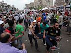 PHOTO: Supporters of Egypts ousted President Mohammed Morsi carry an injured man to a field hospital following clashes with security forces at Nasr City, where pro-Morsi protesters have held a weeks-long sit-in, in Cairo, Egypt, Saturday, July 27, 2013.