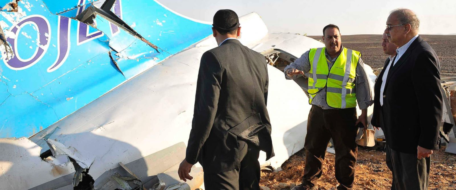PHOTO: In this image released by the Prime Ministers office, Sherif Ismail, right, looks at the remains of a crashed passenger jet in Hassana Egypt, Oct. 31, 2015.