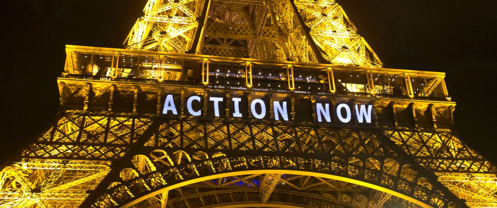 "PHOTO: The Eiffel Tower lights up with the slogan ""Action Now"" referring to the COP21, United Nations Climate Change Conference in Paris, Dec. 6, 2015."