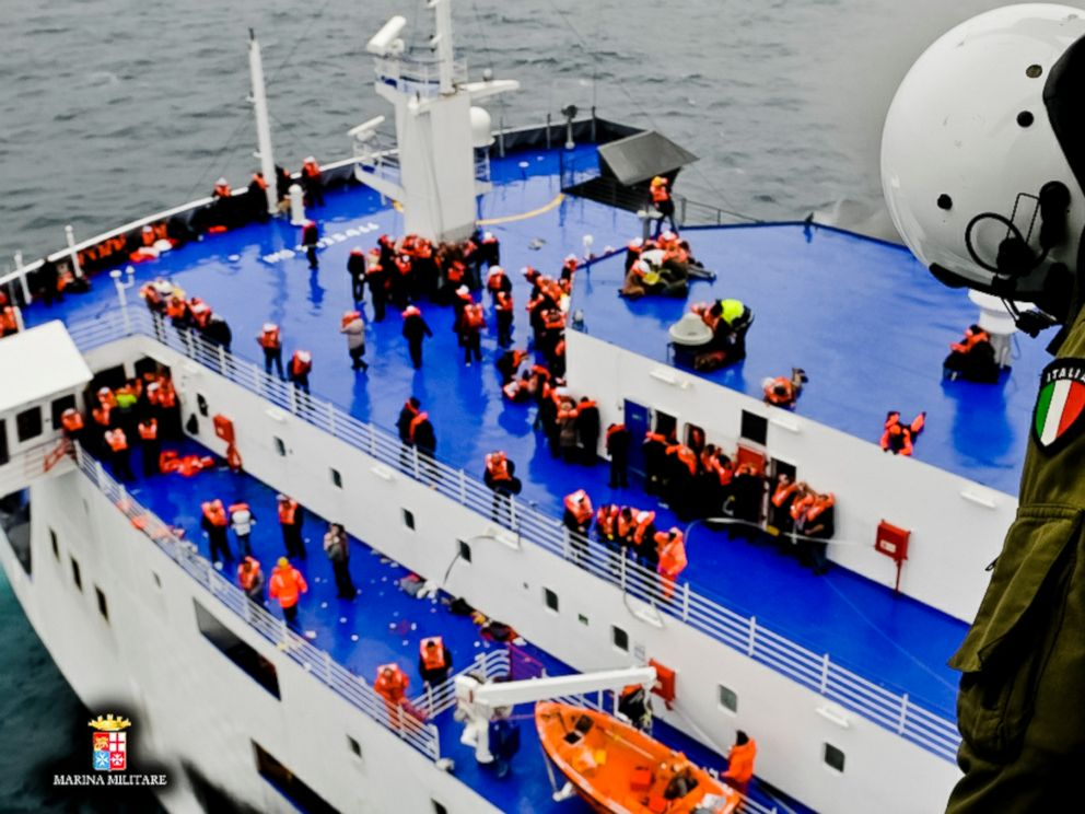 PHOTO: In this image released by the Italian Navy, passengers and crew are seen on the deck of the Italian-flagged ferry Norman Atlantic as it is approached by a rescue helicopter after it caught fire in the Adriatic Sea, Dec. 28, 2014.