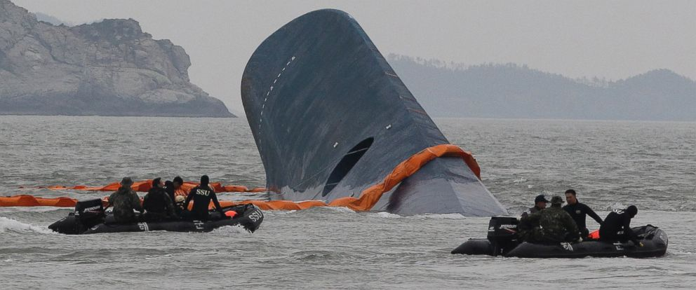 PHOTO: Coast Guard officers search for missing passengers aboard a sunken ferry in the water off the coast of South Korea, April 17, 2014.