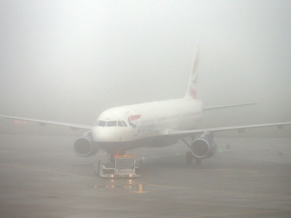 PHOTO: A British Airways plane seen through fog at Terminal 5 Heathrow Airport, London, Nov. 2, 2015.