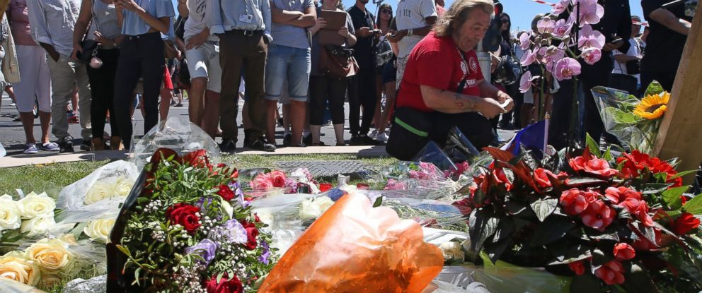 PHOTO: Floral tributes are laid out near the site of the truck attack in the French resort city of Nice, France, July 15, 2016.