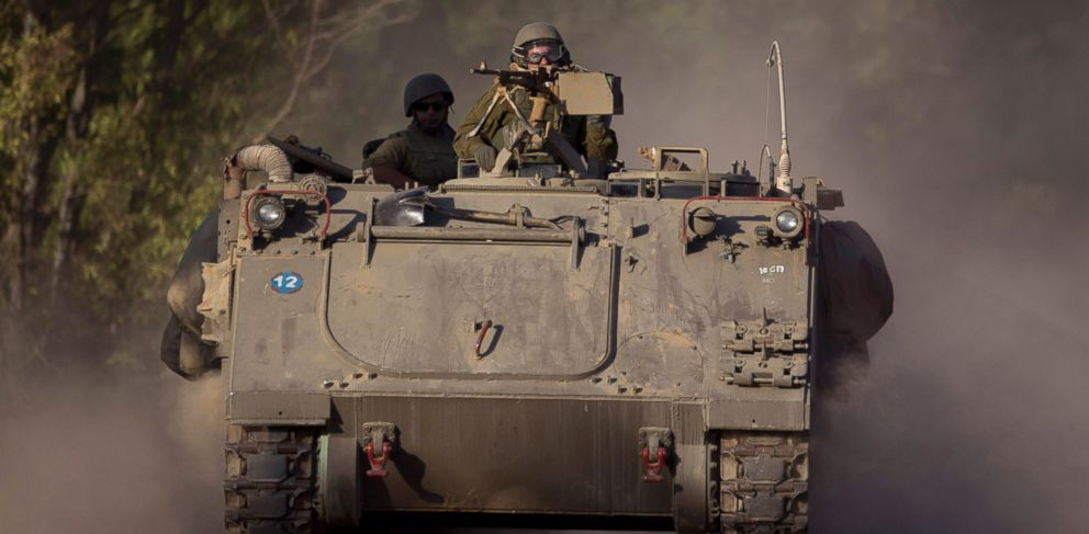 PHOTO: Israeli soldiers drive an armored personnel carrier to a position near the Israel Gaza border, July 10, 2014.