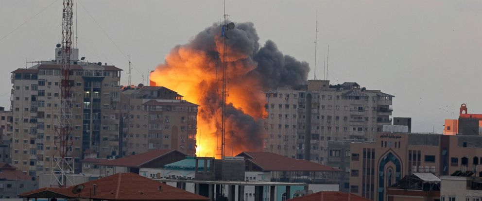 PHOTO: A ball of fire rises from an explosion on al-Zafer apartment tower following an Israeli air strike in Gaza City, in the northern Gaza Strip, Aug. 23, 2014.
