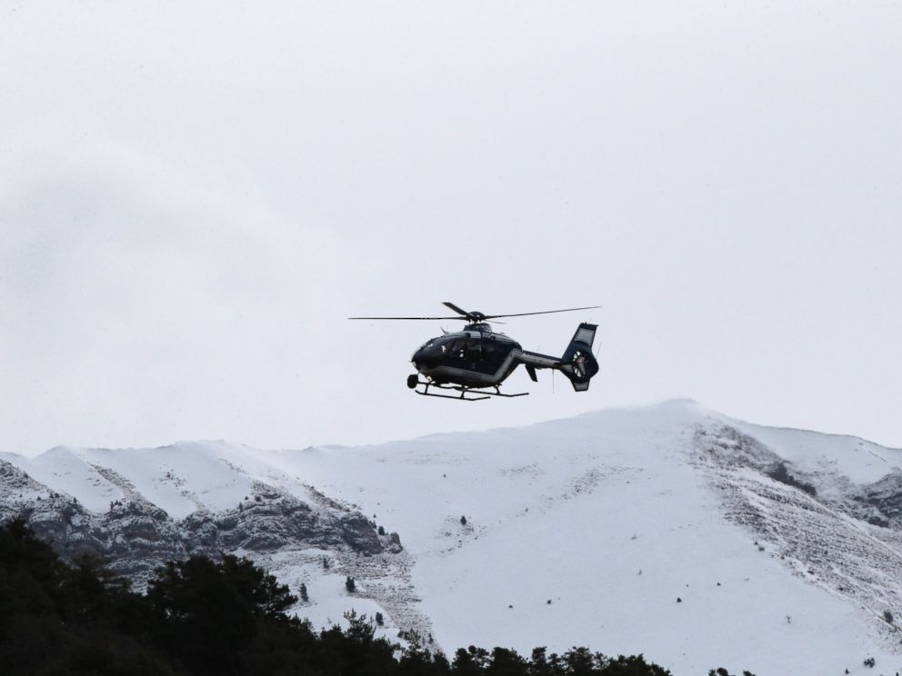 PHOTO: A rescue helicopter flies over mountains near Seyne-les-Alpes, France, to search for the 150 victims who died in a Germanwings plane crash in the French Alps, March 25, 2015.