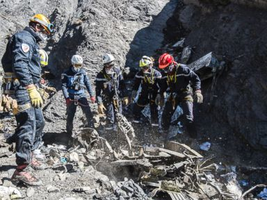 PHOTO: French emergency rescue services work among debris of the Germanwings passenger jet at the crash site near Seyne-les-Alpes, France, March 31, 2015.
