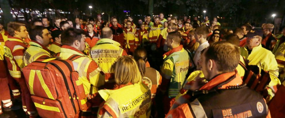 PHOTO: Rescue workers stand outside the stadium as the soccer match between Germany and the Netherlands was cancelled in Hannover, Germany, Nov. 17, 2015.