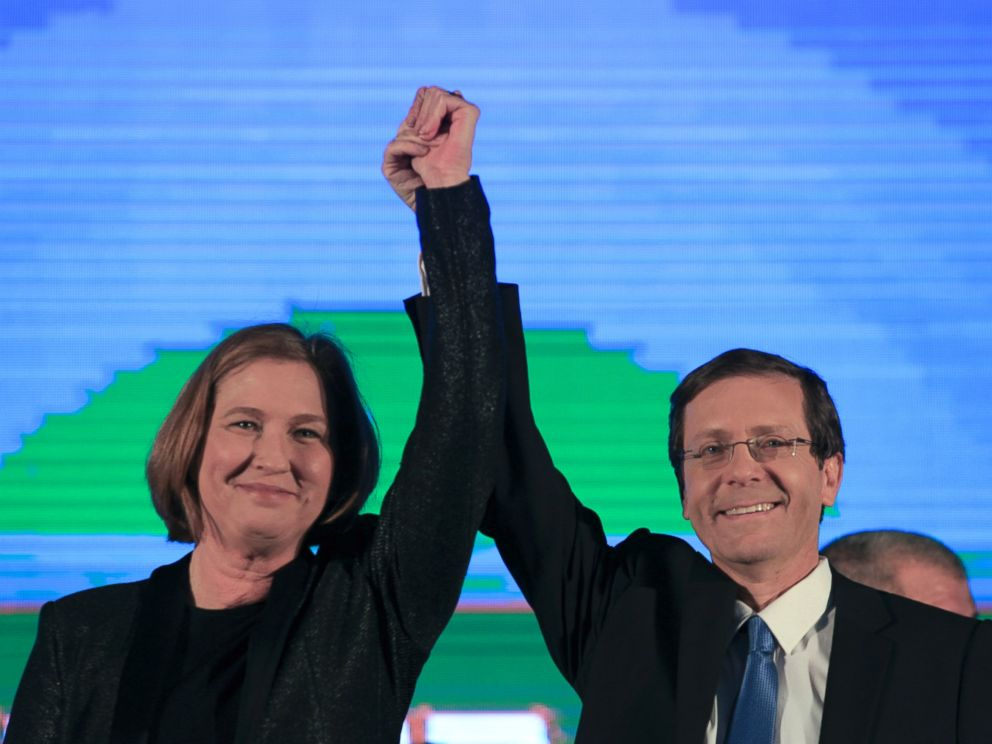 PHOTO: Zionist Union party co-leadesr Isaac Hezcog, right, and Tzipi Livni greet supporters at the partys election headquarters in Tel Aviv, March 18, 2015.