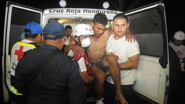 PHOTO: An injured inmate is carried as he arrives at the hospital after a fire broke out at the prison in Comayagua, Honduras, a town 90 miles north of the Central American country's capital, Tegucigalpa, Feb. 15, 2012.