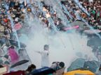 PHOTO: Riot police launch tear gas into the crowd as thousands of protesters surround the government headquarters in Hong Kong, Sept. 28, 2014.