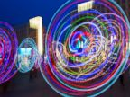 PHOTO: Hoopers perform with illuminated hula hoops during a flash mob at Alexanderplatz in Berlin, June 27, 2014.