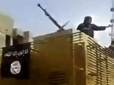 Black Flag of ISIS Militants Hangs Over Iraq Refinery