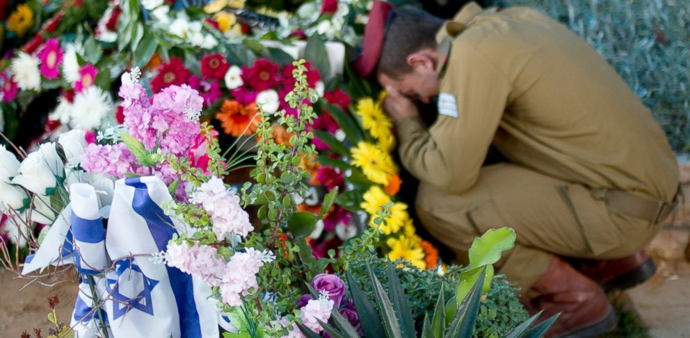 PHOTO: An Israeli soldier morns over the grave of an elite unit soldier during his funeral in a military cemetery in Rishon Letzion, central Israel, July 31, 2014.