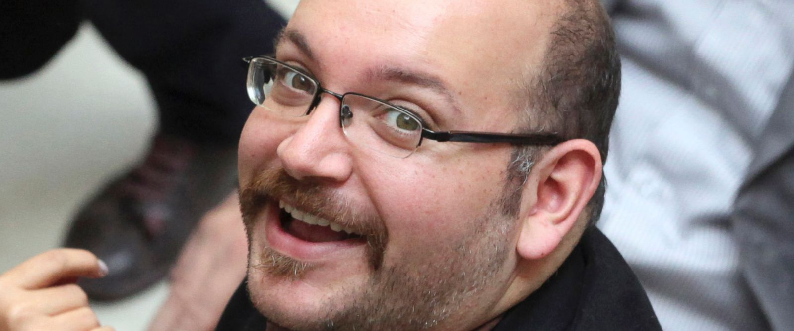 PHOTO: In this photo April 11, 2013 file photo, Jason Rezaian, an Iranian-American correspondent for the Washington Post, smiles as he attends a presidential campaign of President Hassan Rouhani, in Tehran, Iran.