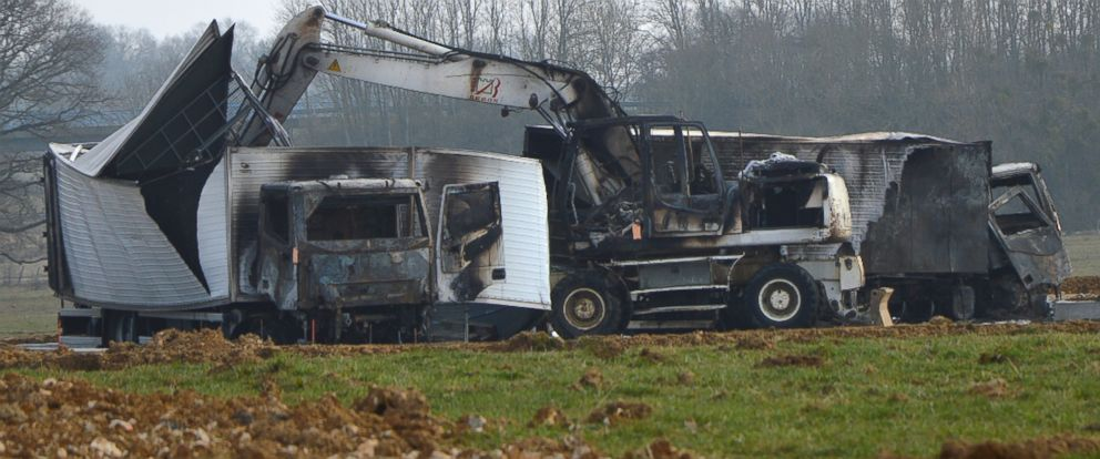 PHOTO: Burnt out vans are seen near the Avallon motorway exit, in central France, on March 11, 2015.