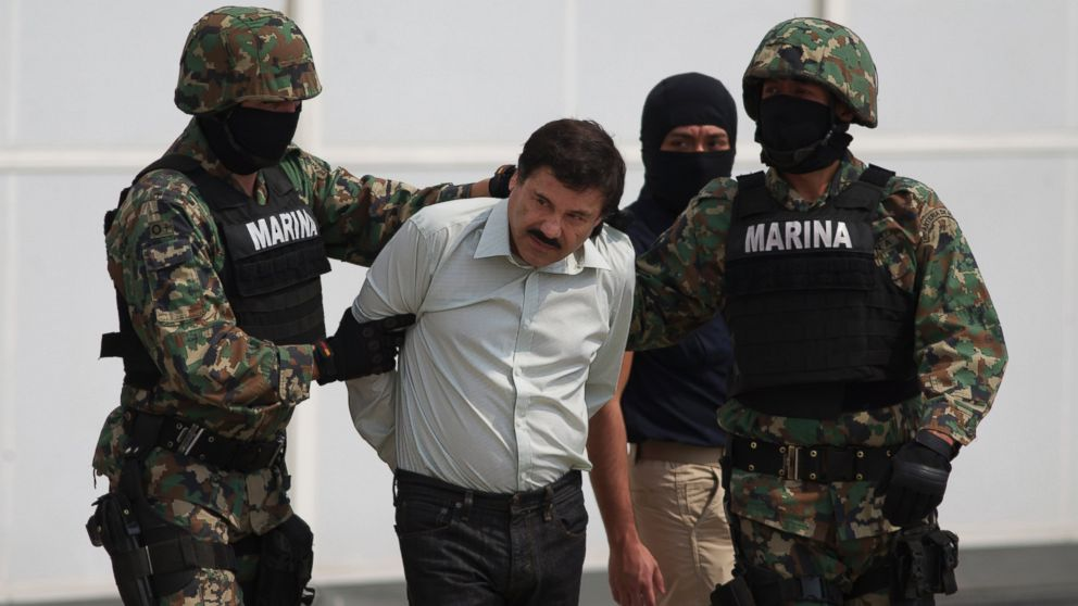 "PHOTO: Joaquin ""El Chapo"" Guzman is escorted to a helicopter in handcuffs by Mexican navy marines at a navy hanger in Mexico City, Mexico, Saturday, Feb. 22, 2014."