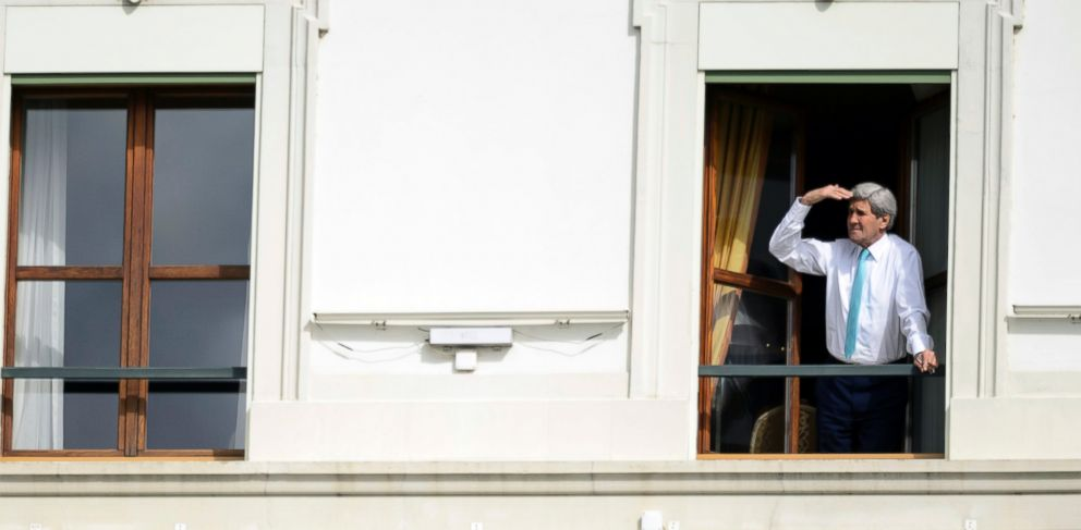 PHOTO: John Kerry looks at the view of Lake Geneva from his hotel room as the Iran nuclear talks continue in Lausanne, Switzerland, April 1, 2015.