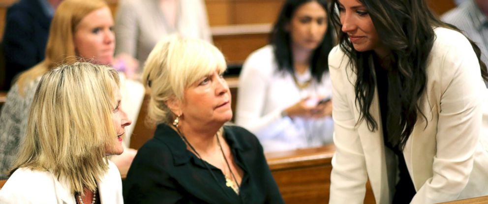 PHOTO: Aimee Pistorius, sister of Oscar Pistorius, right, talks to June Steenkamp, left, mother of the late Reeva Seenkamp, and friend Jenny Strydom, center, before court hearings begins in Pretoria, South Africa, March 17, 2014.