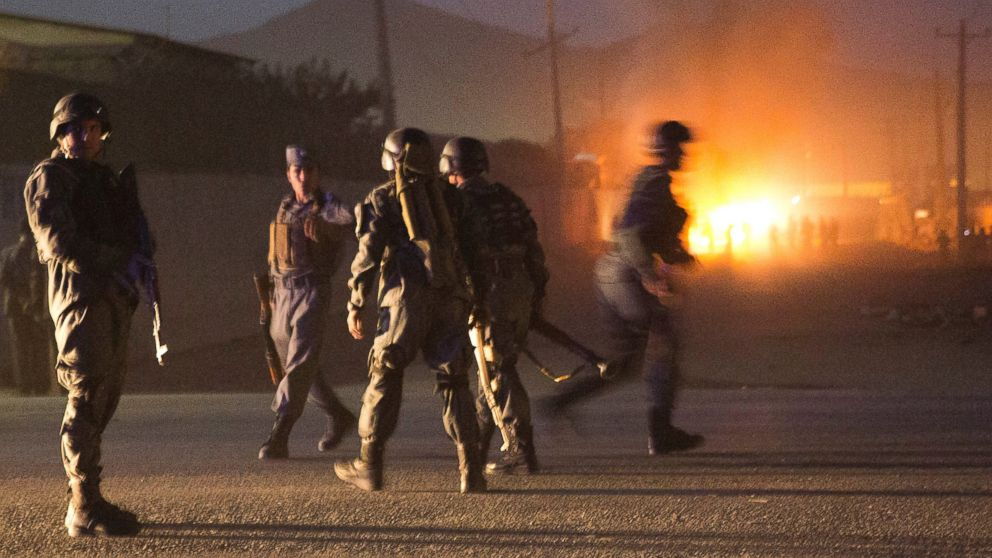 PHOTO: Afghan police arrive to secure the area after a car bomb detonated outside an ISAF civilian personnel compound in Kabul, Afghanistan, Oct 18, 2013.