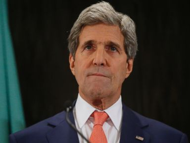 PHOTO: Secretary of State John Kerry listens to remarks by Nabil al-Araby
