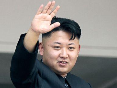 PHOTO: North Koreas leader Kim Jong Un waves to spectators and participants of a mass military parade, July 27, 2013, in Pyongyang, North Korea.
