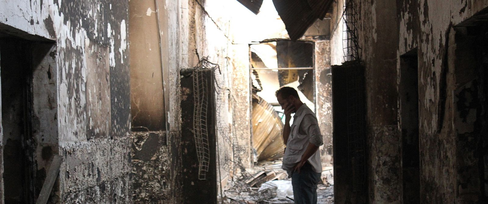 PHOTO:In this, Oct. 16, 2015, file photo, an employee of Doctors Without Borders walks inside the charred remains of their hospital after it was hit by a U.S. airstrike in Kunduz, Afghanistan.