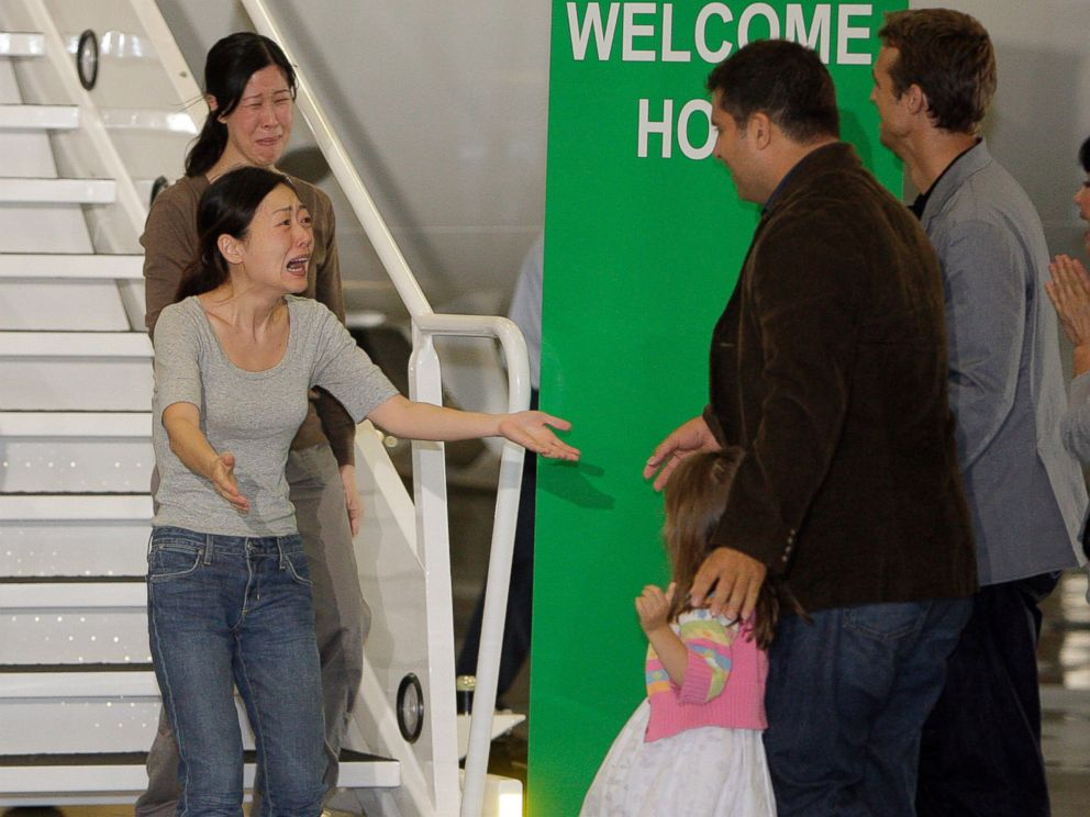 PHOTO: Euna Lee, left, and Laura Ling, two American journalists who were arrested in March after allegedly crossing into North Korea from China, are greeted after the two arrive at Bob Hope Airport in Burbank, Calif., Aug. 5, 2009.