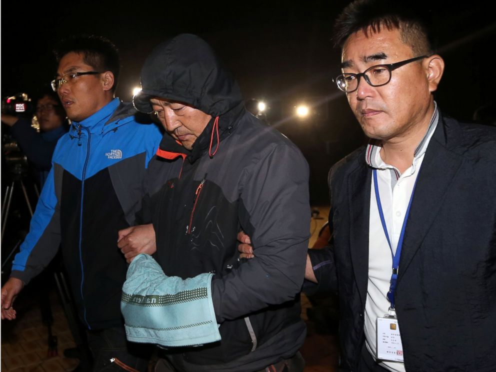 PHOTO: Lee Joon-seok, center, the captain of the sunken ferry Sewol in the water off the southern coast, leaves a court which issued his arrest warrant in Mokpo, south of Seoul, South Korea, April 19, 2014.