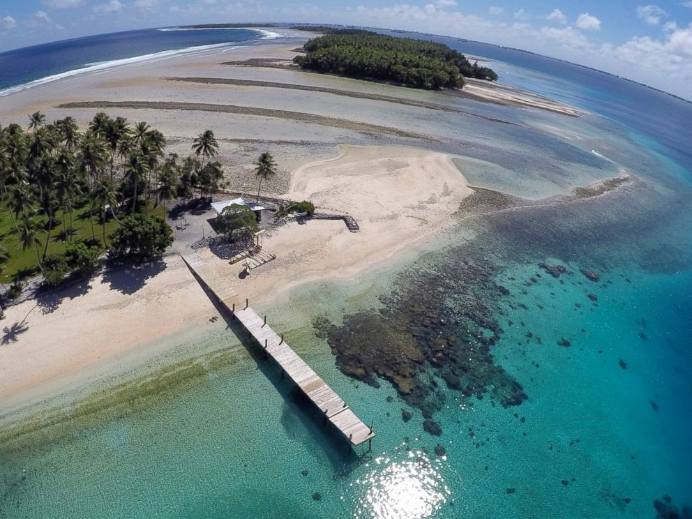PHOTO: This Nov. 8, 2015 aerial file photo shows a small section of the atoll that has slipped beneath the water line only showing a small pile of rocks at low tide on Majuro Atoll in the Marshall Islands.