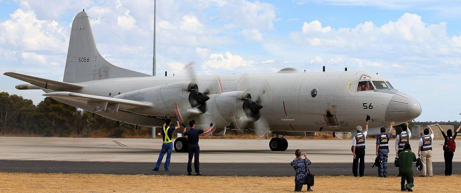 PHOTO: Japan Maritime Self-Defense Force farewell their P-3C Orion as it taxis from the Royal Australian Air Force Pearce Base to commence a search for possible debris from the missing Malaysia Airlines flight MH370, in Perth, Australia, March 24, 2014.
