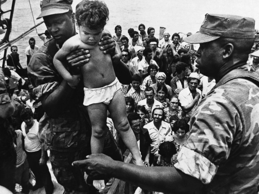 PHOTO: In 1980, Fidel Castro opened up the Mariel port in Cuba for residents to leave. A U.S. Marine helped a young Cuban child off one of the refugee boats poured into Key West for weeks, May 10, 1980.