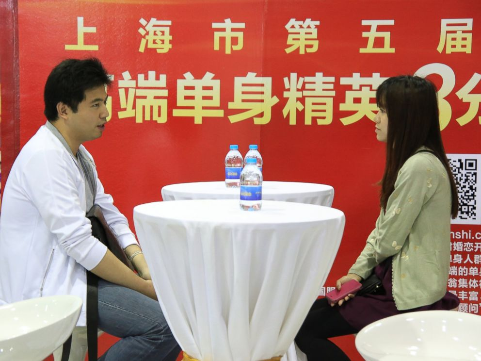 PHOTO: A pair of unmarried participants talk with each other at a massive matchmaking event in Shanghai, China, May 24, 2014.