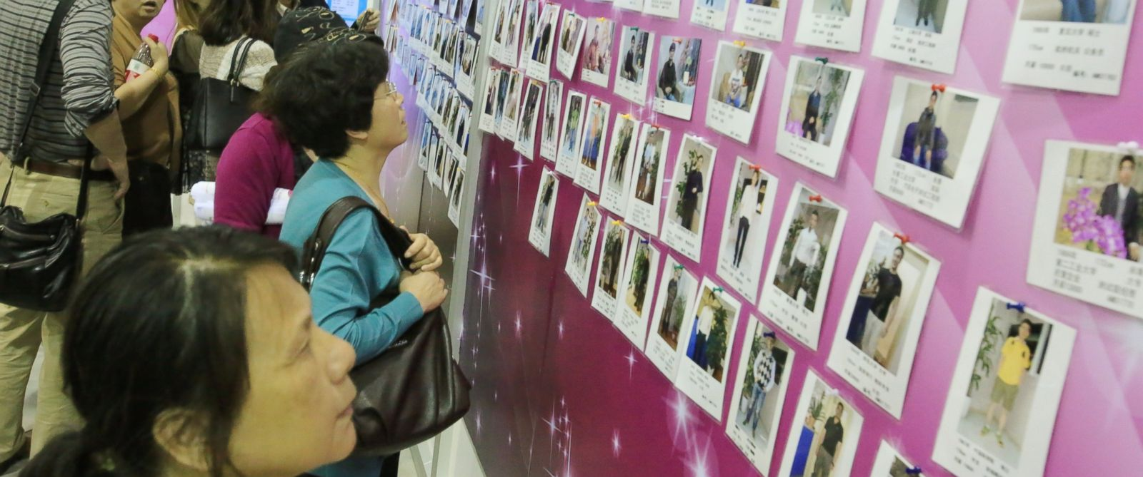 PHOTO: Chinese parents view photos and personal information of male participants for their unmarried daughters at a massive matchmaking event in Shanghai, China, May 24, 2014.