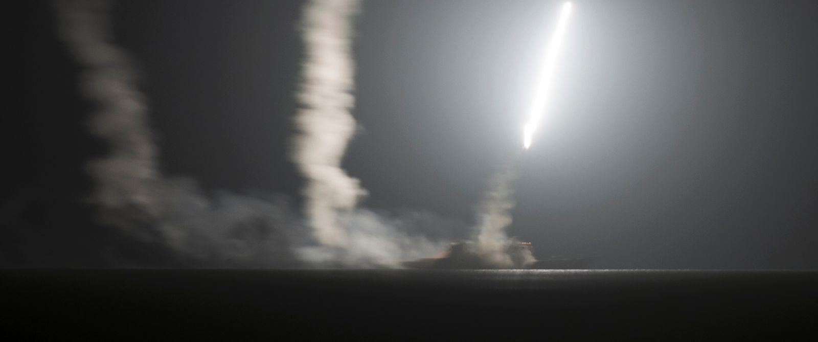 PHOTO: The guided-missile cruiser USS Philippine Sea launches a Tomahawk cruise missile at Islamic State group positions in Syria as seen from the aircraft carrier USS George H.W. Bush on the Arabian Gulf, Sept. 23, 2014.