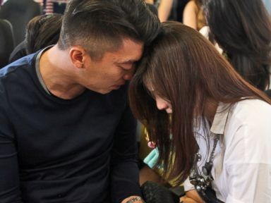 PHOTO: Relatives of the passengers of AirAsia flight QZ8501 comfort each other at Juanda International Airport in Surabaya, East Java, Indonesia, Dec. 28, 2014.