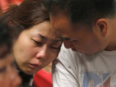 PHOTO: A relative of the passengers of AirAsia flight QZ8501 weeps as she waits for the latest news on the missing jetliner at a crisis center set up by local authority at Juanda International Airport in Surabaya, East Java, Indonesia, Dec. 28, 2014.