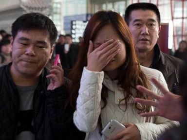 PHOTO: A woman cries at the arrival hall of the International Airport in Beijing, China, Saturday, March 8, 2014.