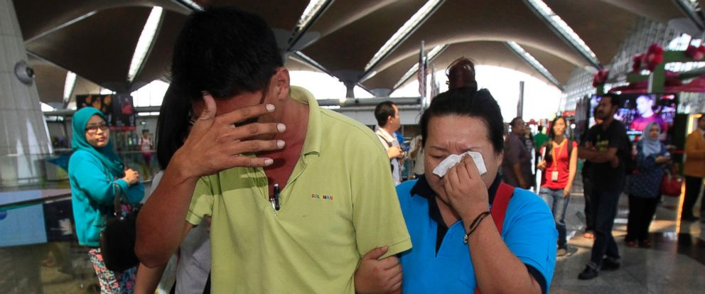 PHOTO: A woman wipes her tears after walking out of the reception center and holding area for family and friend of passengers aboard a missing Malaysia Airlines plane, at Kuala Lumpur International Airport in Sepang, Malaysia, Saturday, March 8, 2014.