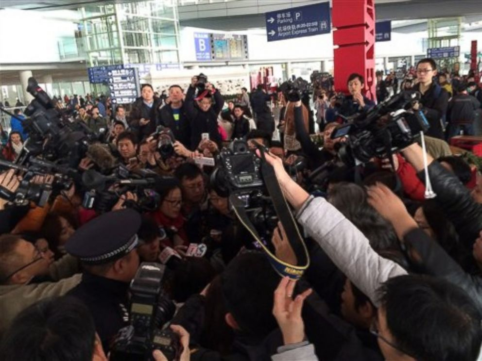 PHOTO: In this photo released by Chinas Xinhua News Agency, reporters crowd at Terminal 3 of Beijing Capital International Airport March 8, 2014 following a report that a Malaysia Airlines plane lost contact on a flight from Kuala Lumpur to Beijing.