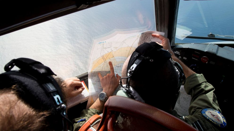PHOTO: Flight Lt. Jayson Nichols looks at a map as he flies aboard a Royal Australian Air Force AP-3C Orion aircraft during a search operation of the missing Malaysian Airlines flight MH370 over the southern Indian Ocean, March 27, 2014.