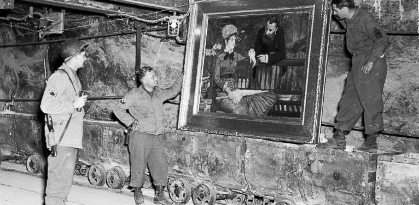 "PHOTO: In this April 25, 1945 image released by the U.S. National Archives, U.S. Army personnel stand by a painting called, ""Wintergarden,"" by French impressionist Edouard Manet, which was discovered in the vault in Merkers, Germany."