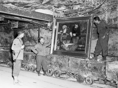 PHOTO: In this April 25, 1945 image released by the U.S. National Archives, U.S. Army personnel stand by a painting called, Wintergarden, by French impressionist Edouard Manet, which was discovered in the vault in Merkers, Germany.